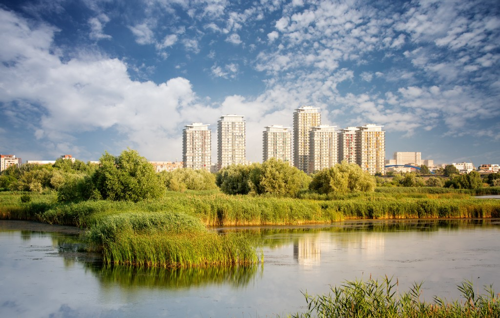 Vacaresti Nature Park - Delta between the blocks with skyscrapers in the background, in Bucharest, Romania. (Credit dpvue studio/Shutterstock)